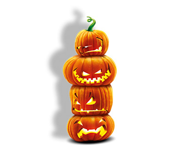 Four carved cartoon pumpkins stacked on top of each other