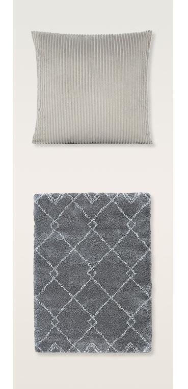 Grey cushion and grey rug with diamond pattern rug