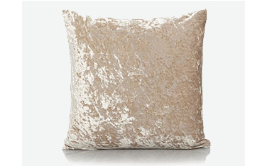 Champagne-coloured crushed velvet cushion