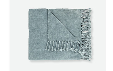 Soft blue throw with tassels