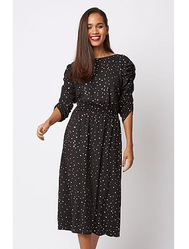 Woman wearing black dotty dress
