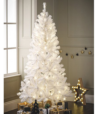 White Christmas tree by the window with presents underneath and a wooden light-up star decoration