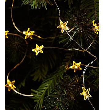 Close up of Christmas tree with yellow star-shaped lights