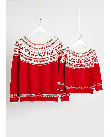 Matching adult and child red Christmas jumpers