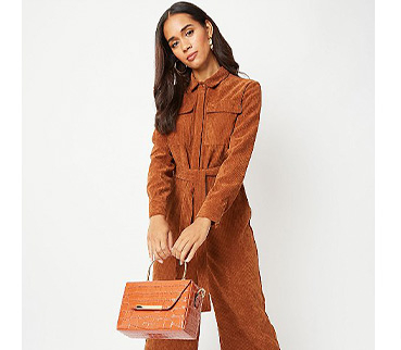 Woman wearing a rust corduroy boiler suit