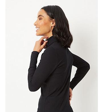 Woman wearing a black roll neck jumper