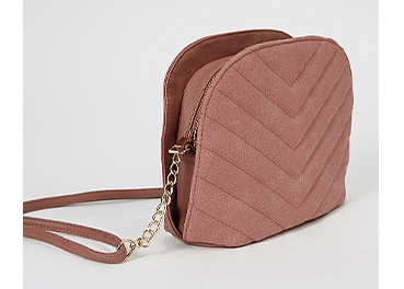 Dusty pink chevron quilted cross body bag