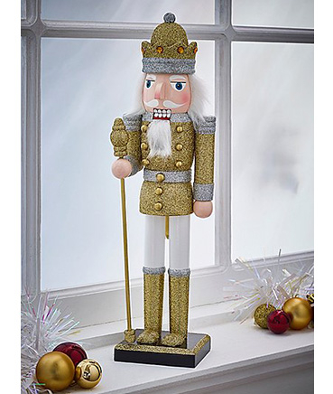 Golden nutcracker Christmas ornament