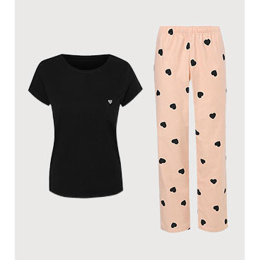 Product image of black pyjama top and pink bottoms with black hearts