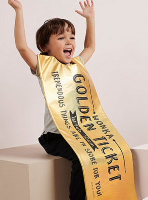 World Book Day 2020 - Boy with his arms raised in happiness wearing a Roald Dahl Willy Wonka Golden Ticket costume