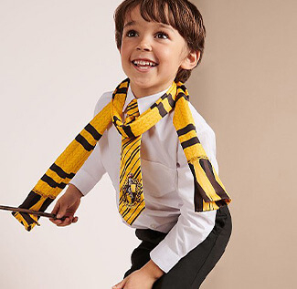 World Book Day 2020 - Boy holding a wand wearing a shirt and trousers with a Harry Potter Hufflepuff scarf and tie