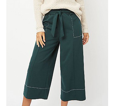Close up shot of green wide leg trousers