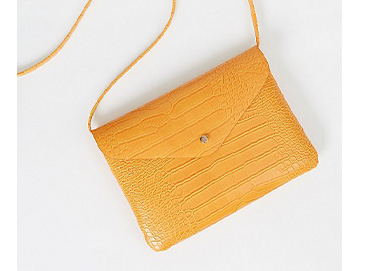 Mustard yellow mock croc cross body bag