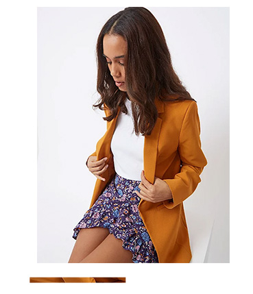 Stand out in a mustard-coloured blazer