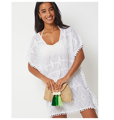 Perfect for popping on over your bikini, this stylish kaftan style cover up is just made for sunny days