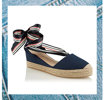 These navy mule sandals come with a ribbon ankle strap for easy wear