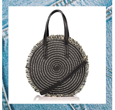 This round woven bag features a gorgeous swirl pattern, long shoulder strap and two handles