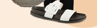 Travel in comfort with a pair of white slip-on sliders