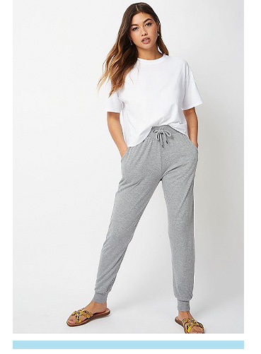 Sport the comfy-casual look with a slouchy white tee and grey joggers