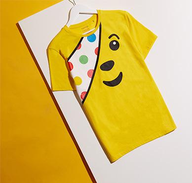 Bird's-eye view of yellow Children in Need Pudsey Bear T-shirt