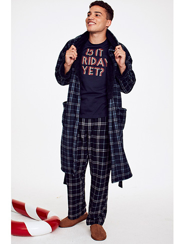 Man wearing a slogan pyjama top, check bottoms and a matching dressing gown