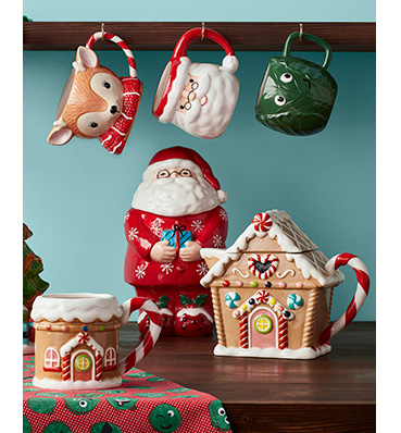 Christmas kitchen mugs and ornaments on a table