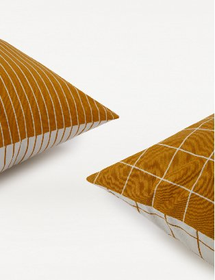 Orange stripe and square print cushions.