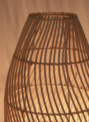Wooden effect rattan floor lamp.