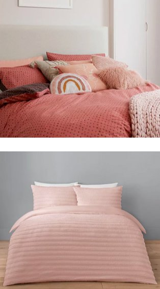 White room features double bed with pink reversible duvet set, rainbow-shaped cushion, faux-fur cushion and assorted pink and cream cushions.