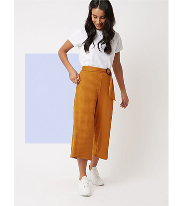 Channel a pair of floaty palazzo trousers