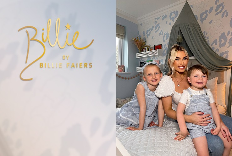 Billie Faiers and her two children Nelly and Arthur sit huddled together smiling on a double bed in white and blue room with green canopy.