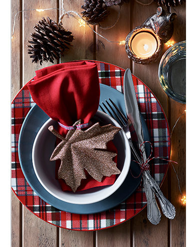 Luxury 16 piece tartan dinner set laid on wooden table
