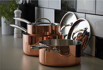 Set of copper saucepans