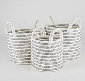 Three grey and white striped storage baskets with handles