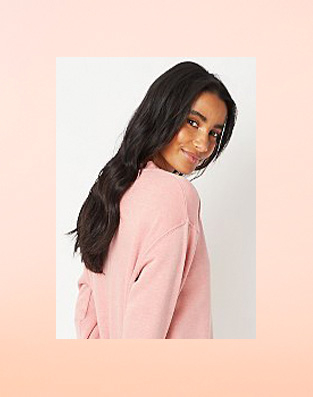 Woman in pink slouchy jumper