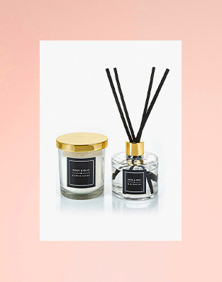 Black and gold candle and inscent with sticks