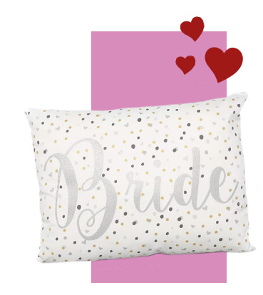 This cushion is patterned with polka dots and a shimmery silver print 'Bride' slogan