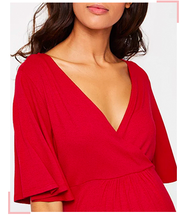 Liven up your pregnancy wardrobe with this vibrant red wrap style dress
