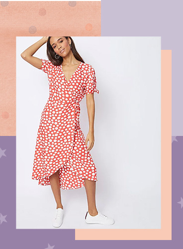 Designed in a light red hue with white spots, this midi wrap dress is a great option for sunny days