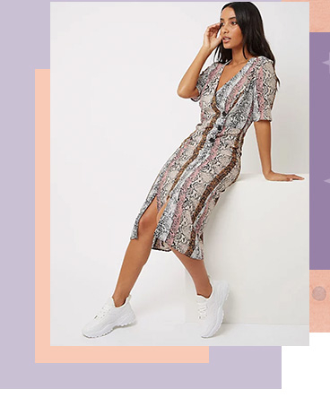 This midi wrap dress is designed with standout snakeskin print