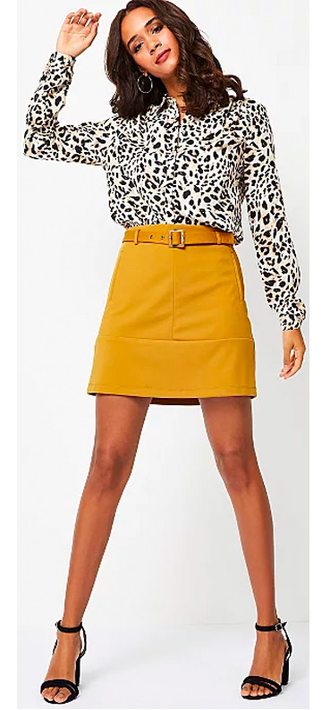 Our Mustard Square Buckle Belted A-Line Skirt has a self-tie square buckle waist belt
