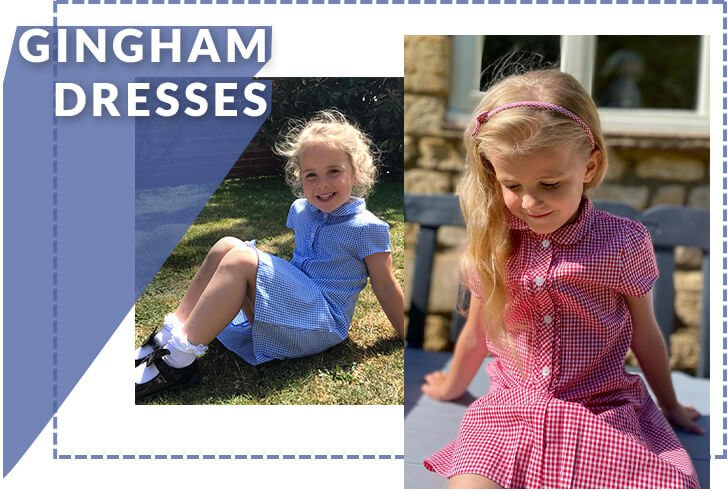 A girl sitting on the grass wearing a blue gingham dress with white frilly socks and black shoes and a girl sitting on a bench wearing a red gingham dress with matching headband
