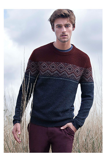A model wears a knitted jumper