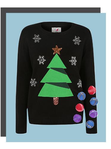 A women's Christmas tree jumper