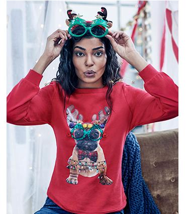 A female model wears a pug Christmas Jumper