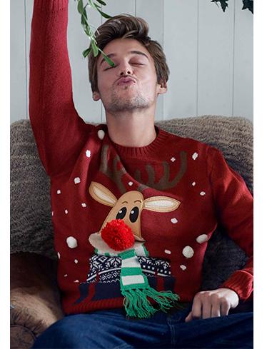 A male model wears a reindeer Christmas jumper