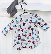 White Disney Minnie Mouse and Daisy Duck smock top.