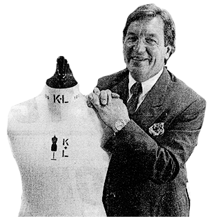 George Davies, founder of George, standing next to a mannequin