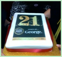 Cake with 21st Birthday decorations to celebrate George's 21st anniversary