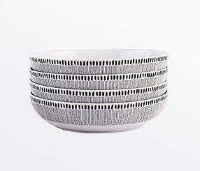 A stack of white and black patterned bowls
